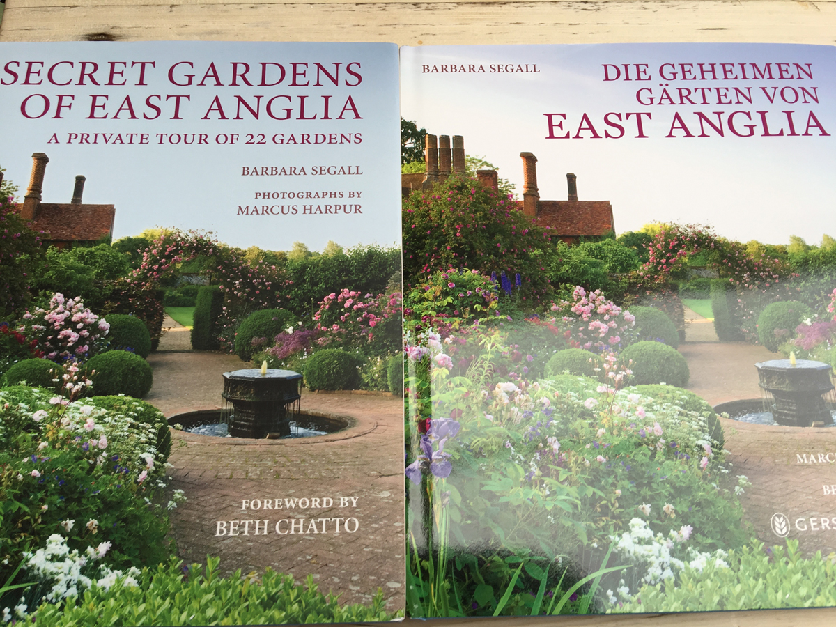 German and English covers of Secret Gardens of East Anglia